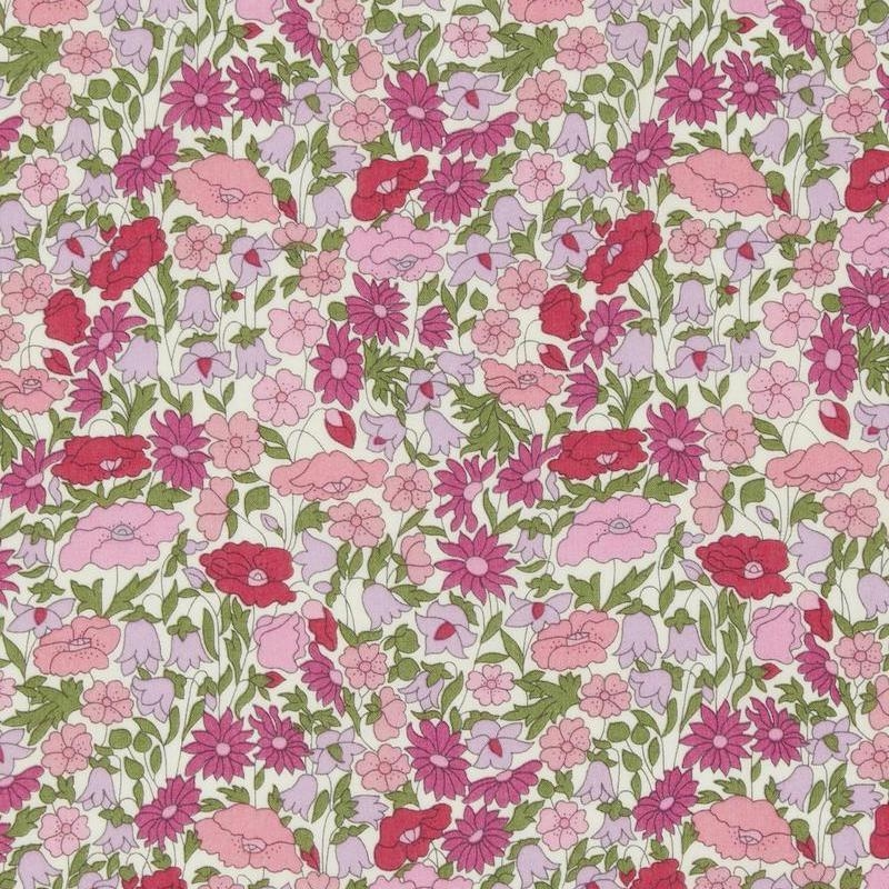 Liberty Poppy Forest print with pink and fuchsia flowers on a cream background.